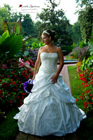 Beautiful bride strikes a pose at garden.