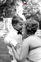 Candid moment between ring bearer and bride - monroe, nc