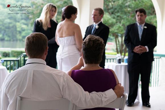 Bride's parents watch the wedding ceremony