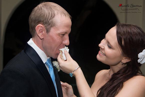 Bride feeds groom wedding cake