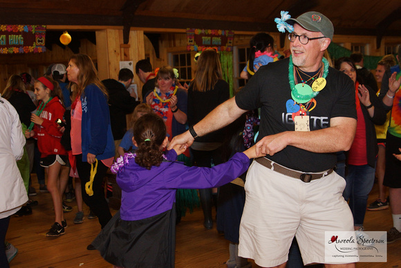 Dr. Rene dances with one of the heart kids