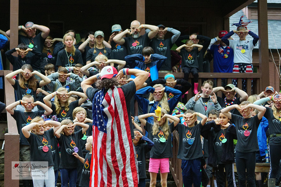 Camp director teaches song at 2016 Camp Luck.