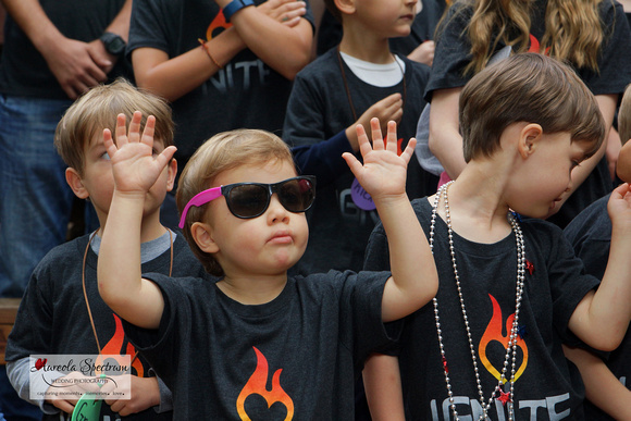 Heart kid wears sunglasses at camp luck 2016.