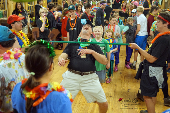 Assistant camp director and doctor does the limbo.