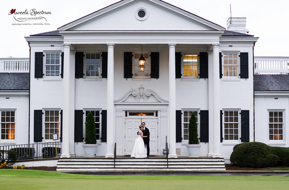 Traditional bride and groom pose in front of country club in Greensboro, NC.