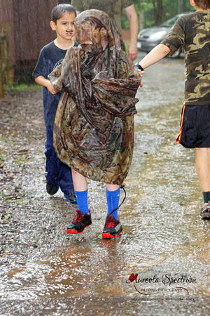 Heart kids playing Rambo at camp luck in the rain.