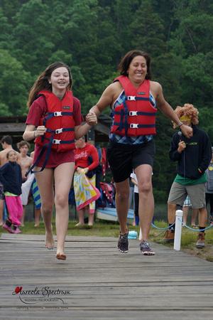 Pair runs down dock at Camp Luck Family Camp.