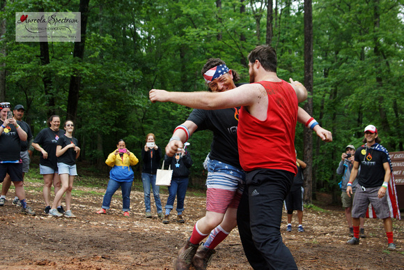 Volunteers mud wrestle at camp luck family camp 2016.