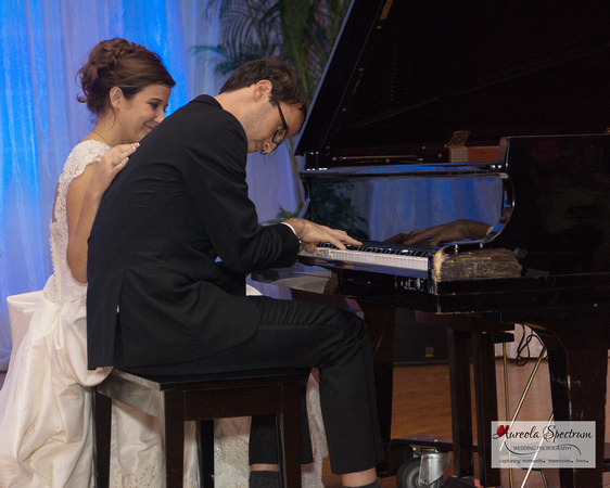 Groom plays the piano for his bride and guests in Greensboro, NC.
