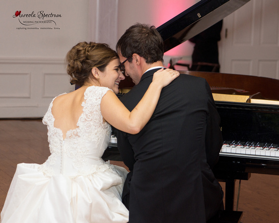 Candid moment between Bride and Groom as he plays the piano at their Greensboro, NC wedding.