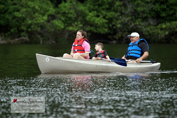 Heart family in canoe during camp luck.