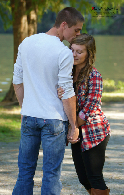 Groom sweetly kisses Bride in Lake Lure, NC
