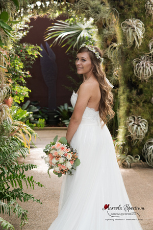 Bride smiles inside cacti tunnel.