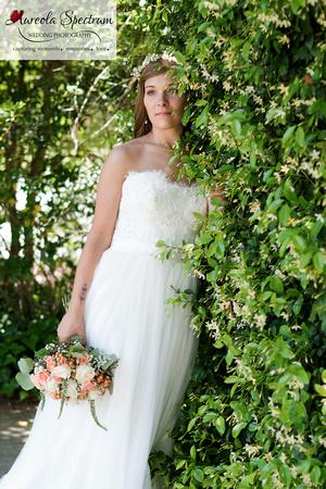 Bride leans into a honeysuckle bush