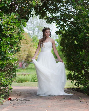 Bride turns side to side in wedding dress in Belmont, NC.
