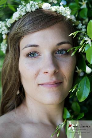Head shot of bride with honeysuckles.