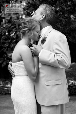 Emotional photo of father/daughter dance at Monroe, NC wedding.