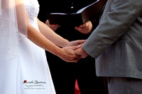 Bride and groom holding hands during Raleigh ceremony