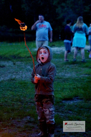 Cute kid roasting marshmallows at Camp Luck 2016.