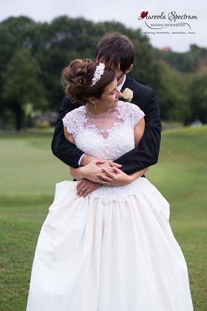 Bride and groom pose on golf course in Greensboro, NC.