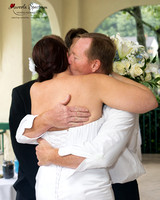 Bride hugs father at the wedding ceremony in Lake Lure, NC