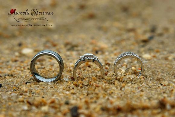 Wedding rings on beach in Lake Lure, NC