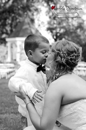 Candid of bride and ring bearer at Monroe, NC wedding.