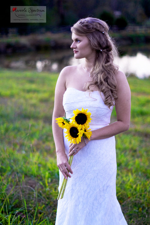 Bride holds sunflowers in Monroe, NC field